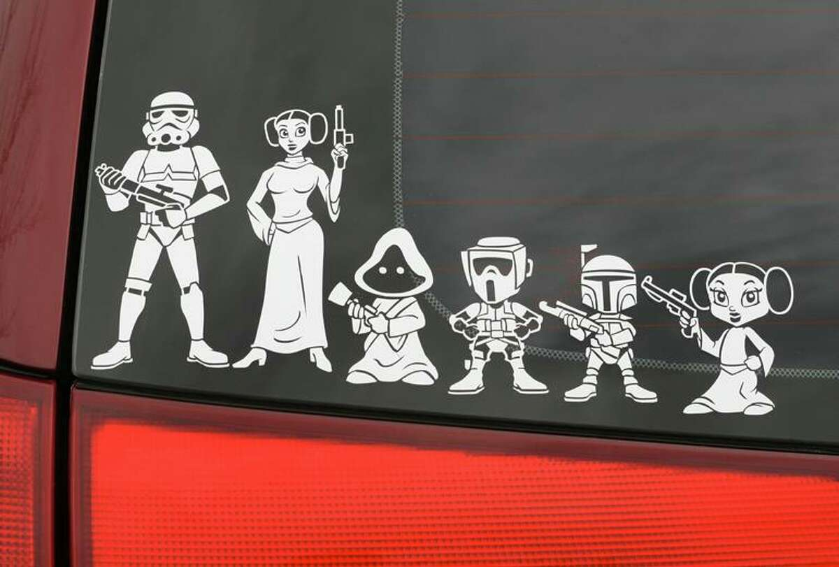 A stormtrooper, Princess Leia and other