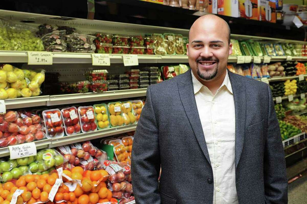 Anthony Pena poses for a photo in City Supermarket on East Main St. in Stamford on Tuesday, March 13, 2012.