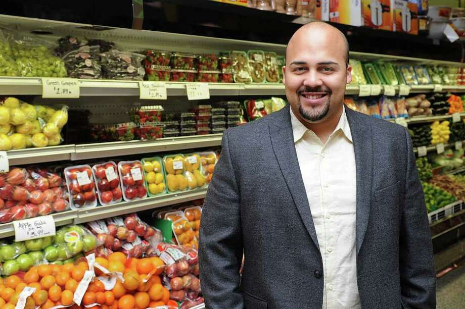 Anthony Pena poses for a photo in City Supermarket on East Main St. in Stamford on Tuesday, March 13, 2012. Photo: Lindsay Niegelberg / Stamford Advocate