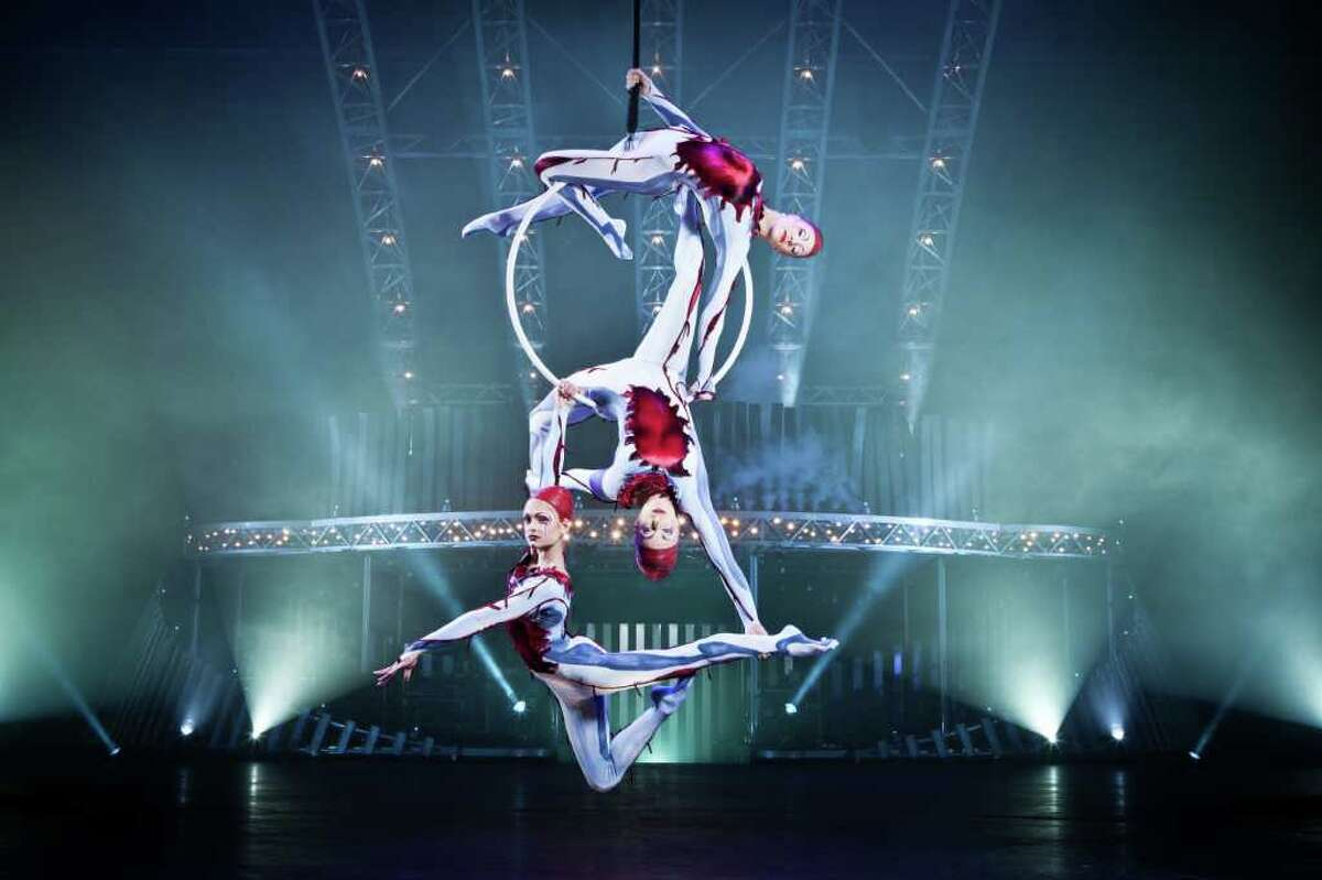 Acrobats perform on a suspended hoop in the Cirque du Soleil production