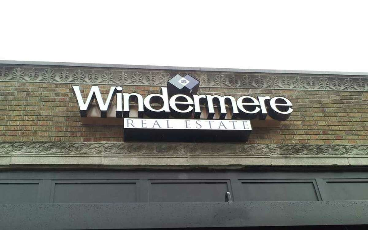 Windermere's current logo is shown on the front of the Wall Street office, in Seattle's Belltown neighborhood.