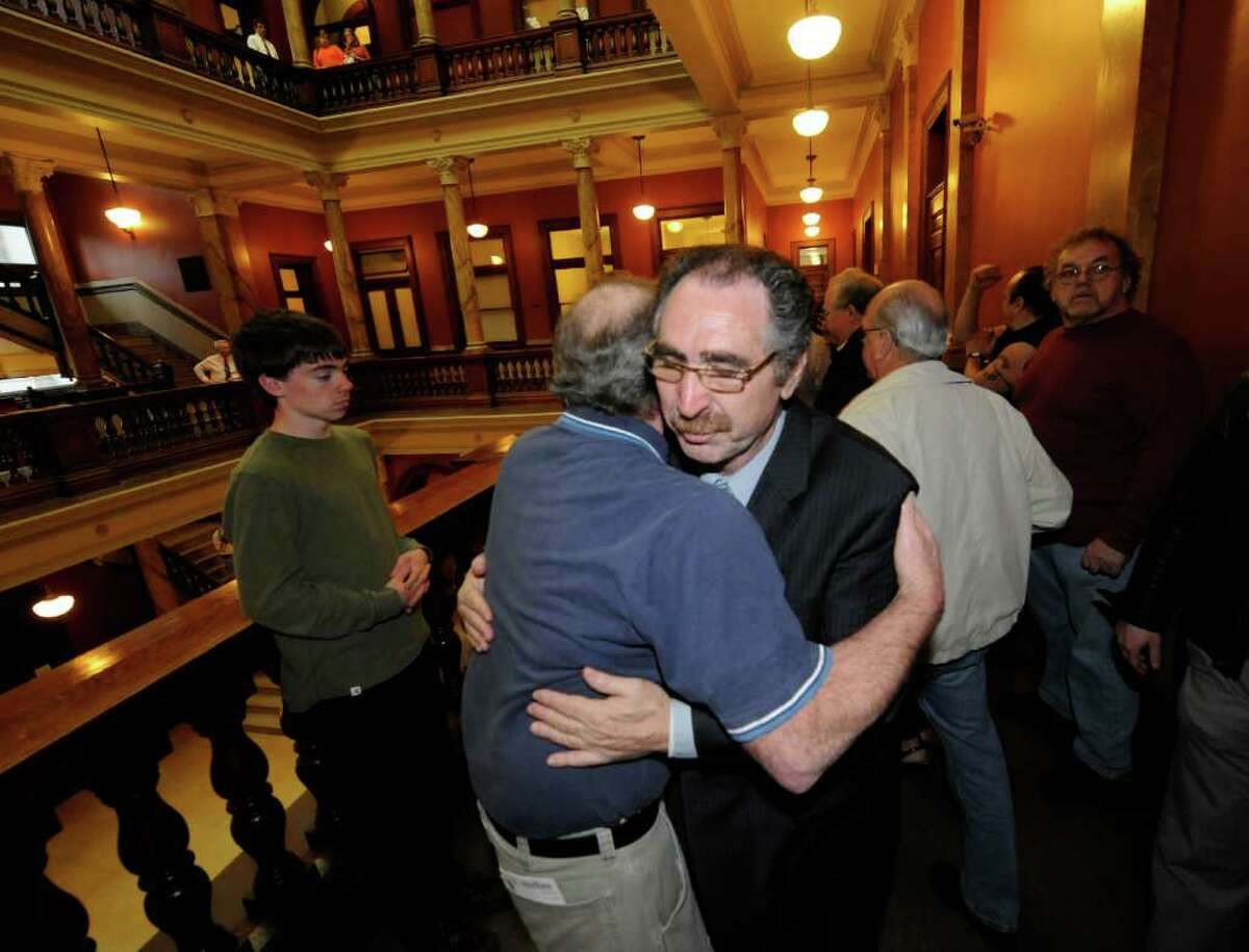 Michael LoPorto gets a hug from a friend as he leaves the courtroom after a hung jury caused Judge George Pulver to declare a mistrial in ballot fraud case in which he was a defendant in Troy, N.Y. March 13, 2012.