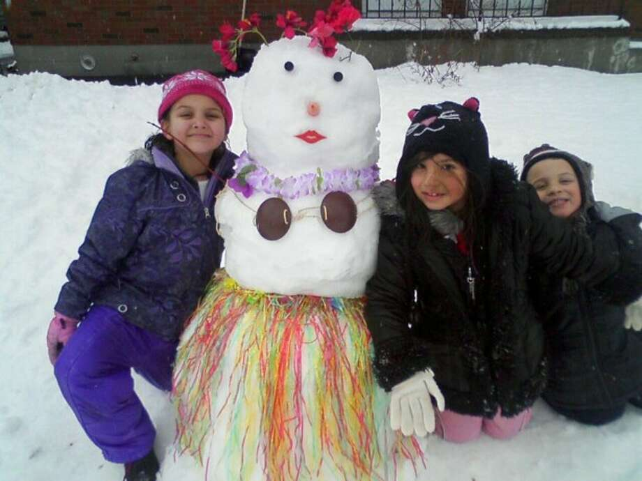 Kyla Zeilman, Alexa Pavone and Camden Banks, all of Colonie, used a recent snowy day to make a South Pacific-style snowman. Nicole Pavone