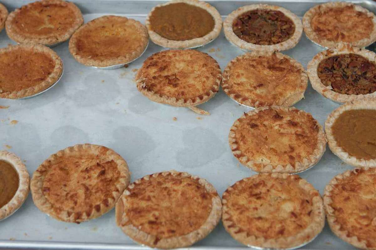 Sally Ann's Catering (77047) sells an assortment of pies, including meat pies and dessert pastries, at the City Hall Farmers' Market in Hermann Square Park. Photo by R. Clayton McKee