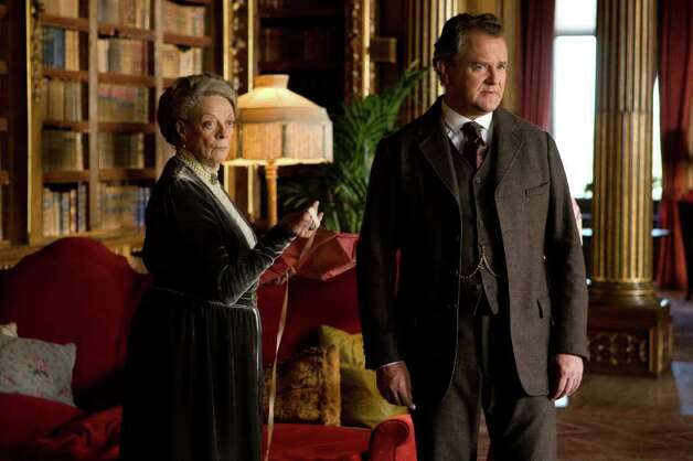 "In this image released by PBS, Maggie Smith as the Dowager Countess, left, and Hugh Boneville as Lord Grantham are shown in a scene from the second season on ""Downton Abbey,"" a drama about life in an English country estate. Photo: AP"