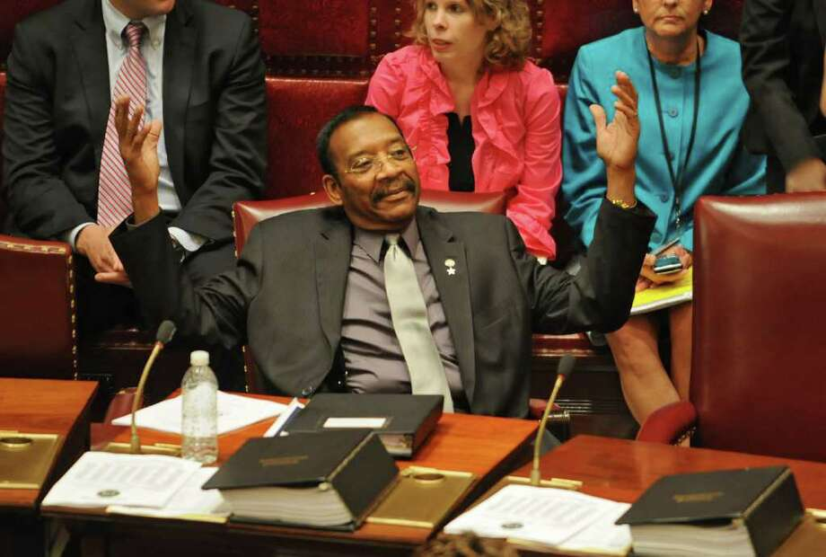 Senator Ruben Diaz Sr. throws up his arms during a vote in the Senate chamber in the Capitol in Albany, NY on June 7, 2010.  (Lori Van Buren / Times Union) Photo: LORI VAN BUREN