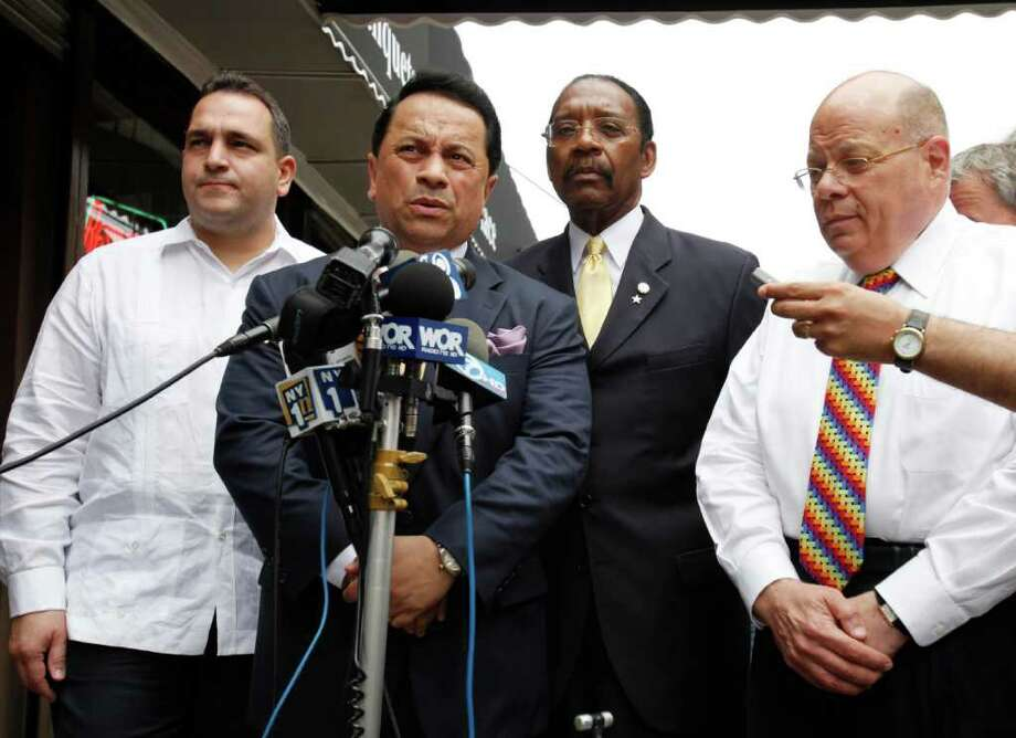 Senators Carl Kruger, right, Ruben Diaz Sr., second from right, Pedro Espada, second from left, and Hiram Monserrate, speak to the media in New York, Monday, July 20, 2009.  (AP Photo/Seth Wenig) Photo: Seth Wenig / AP