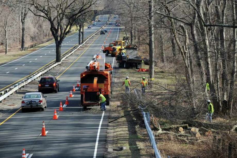 Conn. State Department of Transportation workers trim trees along the Merritt Parkway N just north of the Merwin's lane overpass in Fairfield, Conn. on Monday, march 12, 2012. Photo: Cathy Zuraw / Connecticut Post