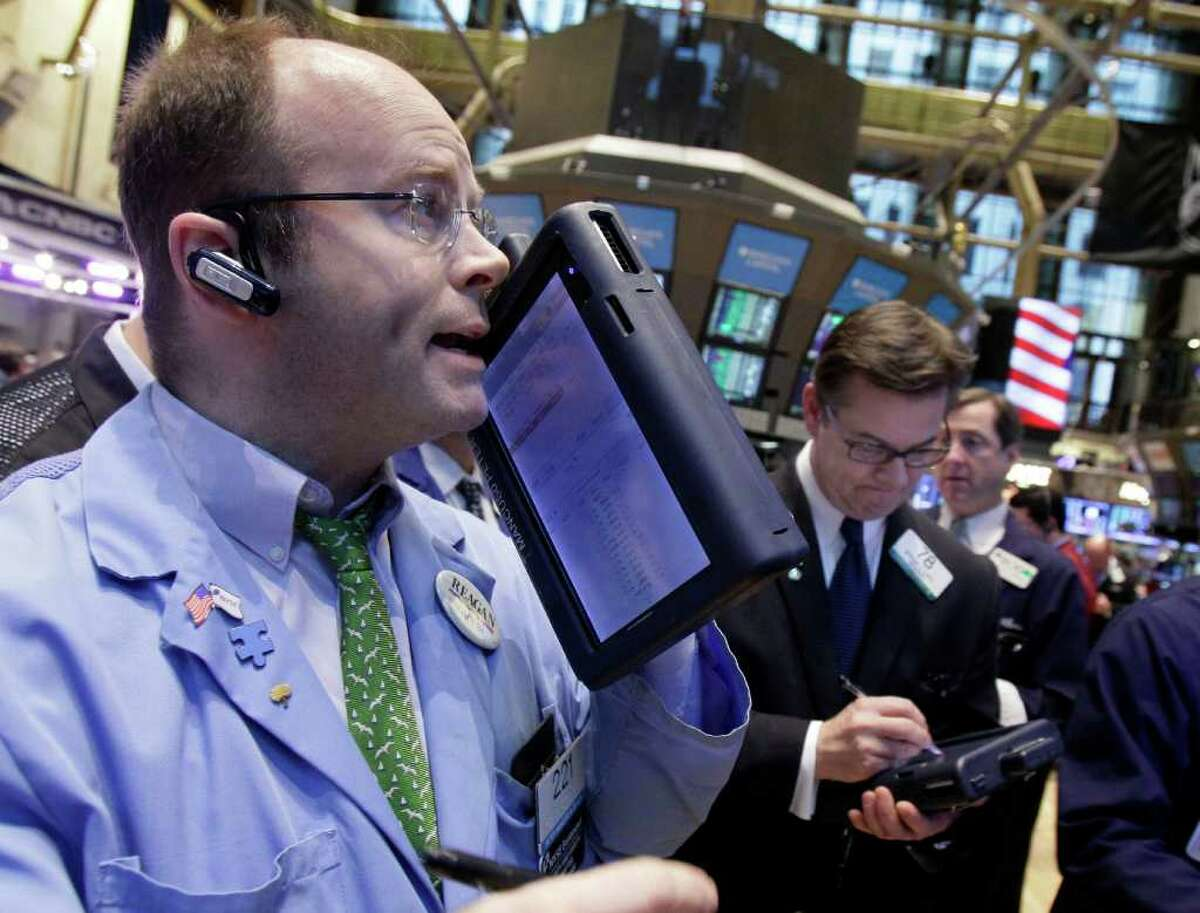Trader Peter Mancuso, left, works on the floor of the New York Stock Exchange Tuesday, March 13, 2012. Strong February retail sales results drove U.S. stocks higher at the opening of trading. (AP Photo/Richard Drew)