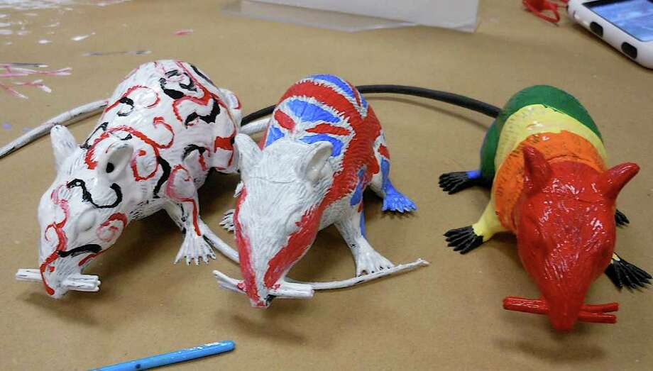 Rubber rats were colorfully painted by teens participating in Fairfield Woods Branch Library's Rat Parade workshop, part  of the Titanic theme of this year's One Book, One Town program. Photo: Mike Lauterborn / Fairfield Citizen contributed