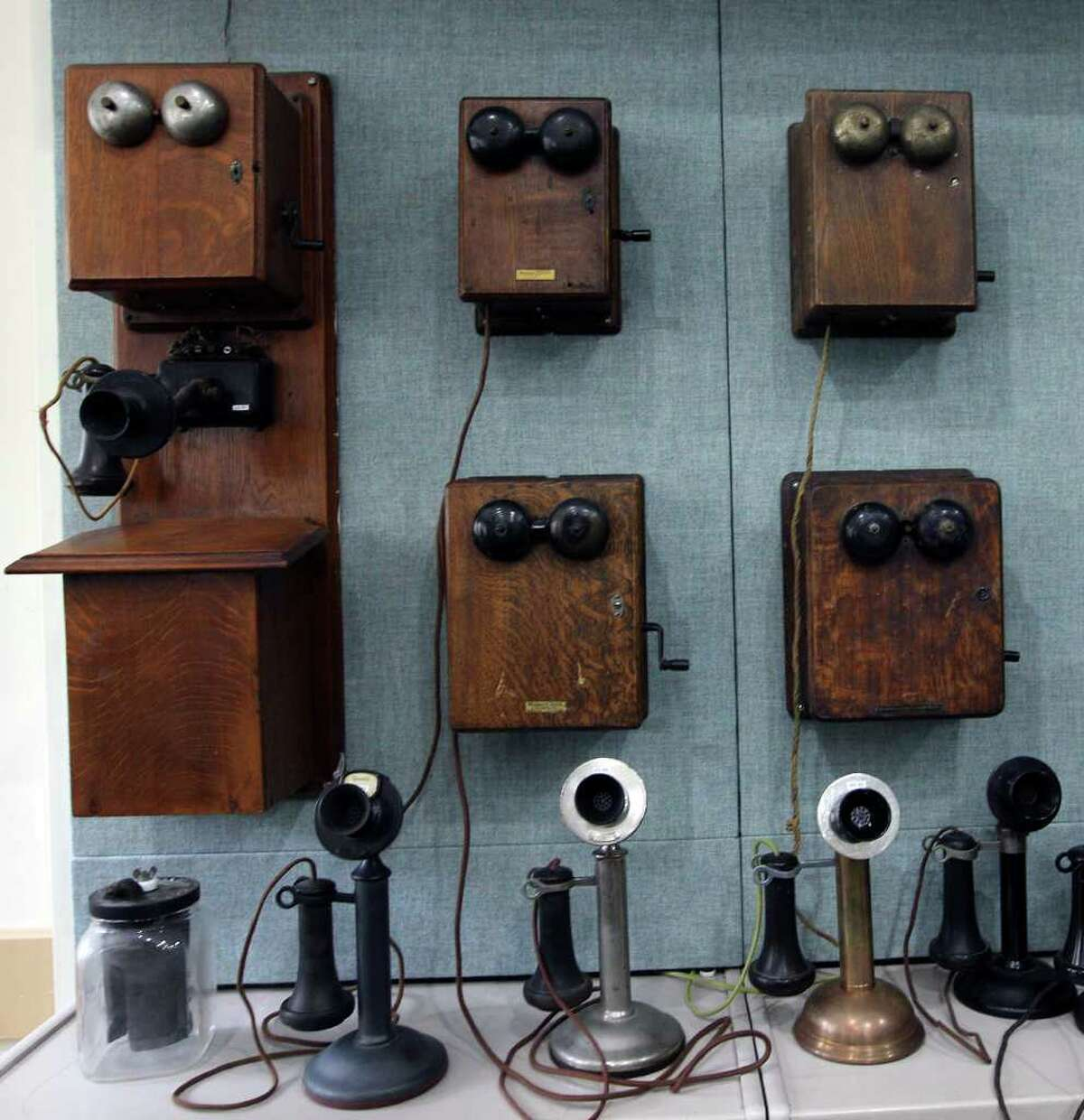 An 1890s magneto Kellogg wall phone (far left) is the oldest phone in the collection.