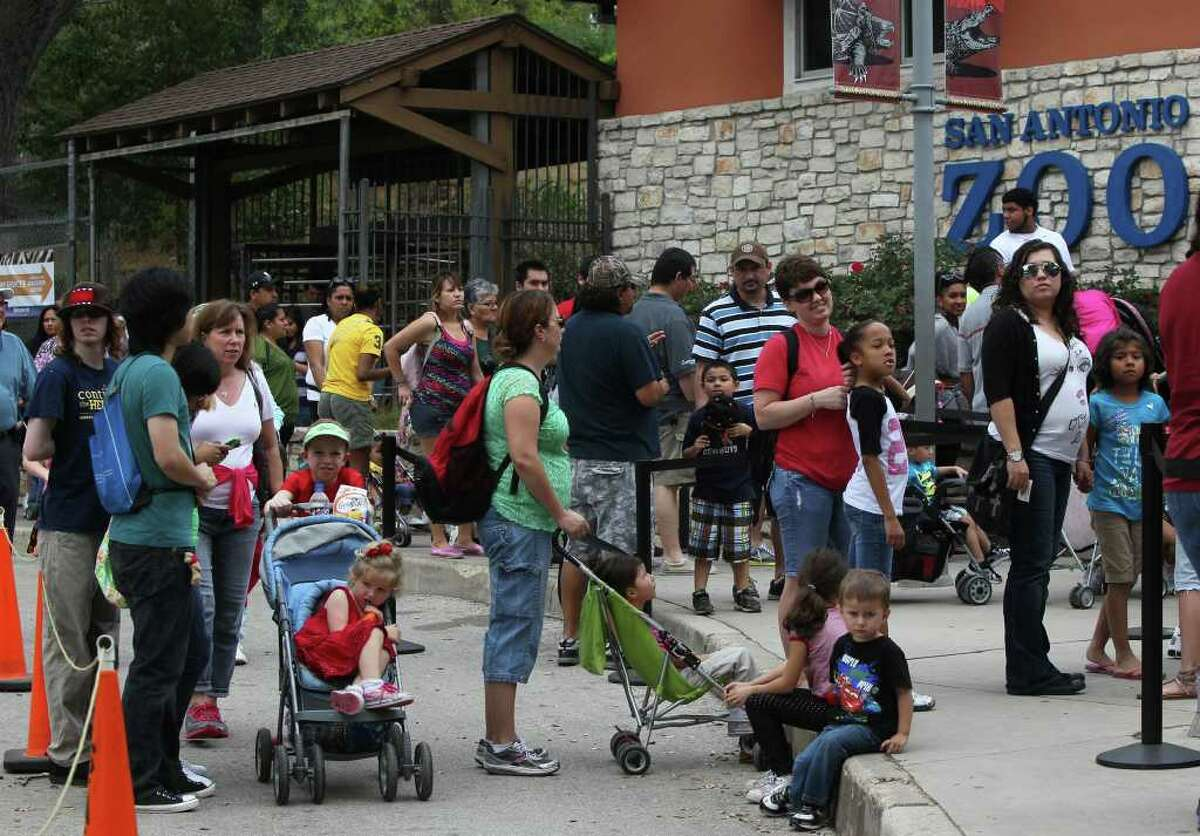 Having hurdled the parking challenge at Brackenridge Park, folks line up for admission to the San Antonio Zoo, which drew 13,000 visitors Monday compared with an everyday crowd of about 3,000.