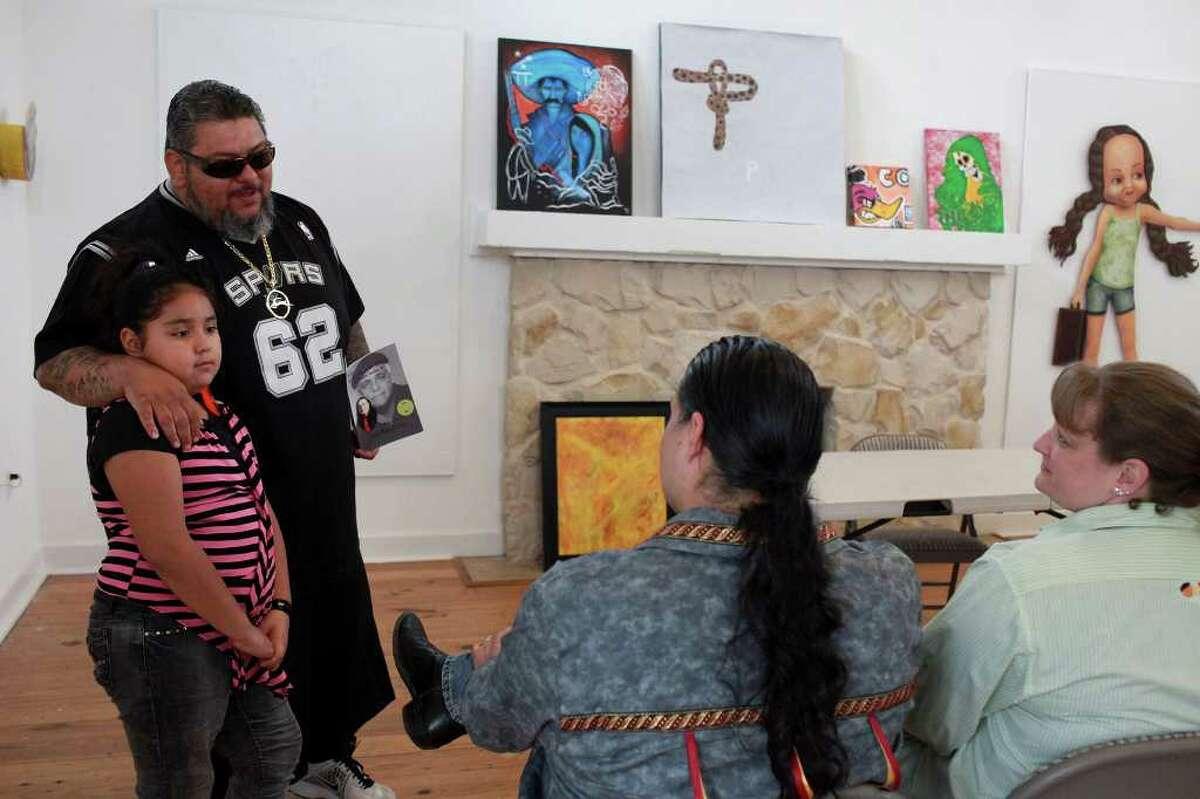 Manuel Galvan, with daughter Angelita Galvan, talks with teachers Juan Manuel Perez, the 2011-12 poet laureate for the San Antonio Poets' Association, and his wife, Malia Perez, as they await the caravan's arrival.