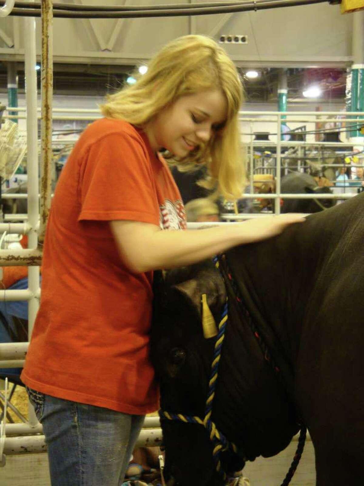Clear Creek High School sophomore Shannon O' Quinn and her Simmental steer, Dax.
