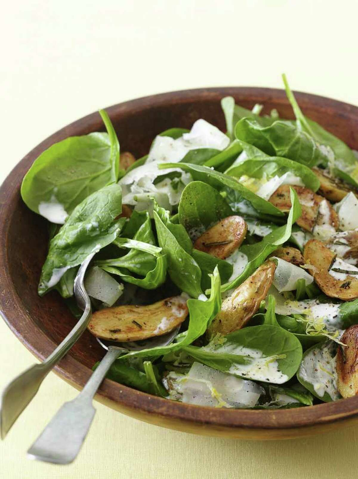 Delish: Redbook recipe for Roasted Potato, Spinach, and Parmesan Salad.