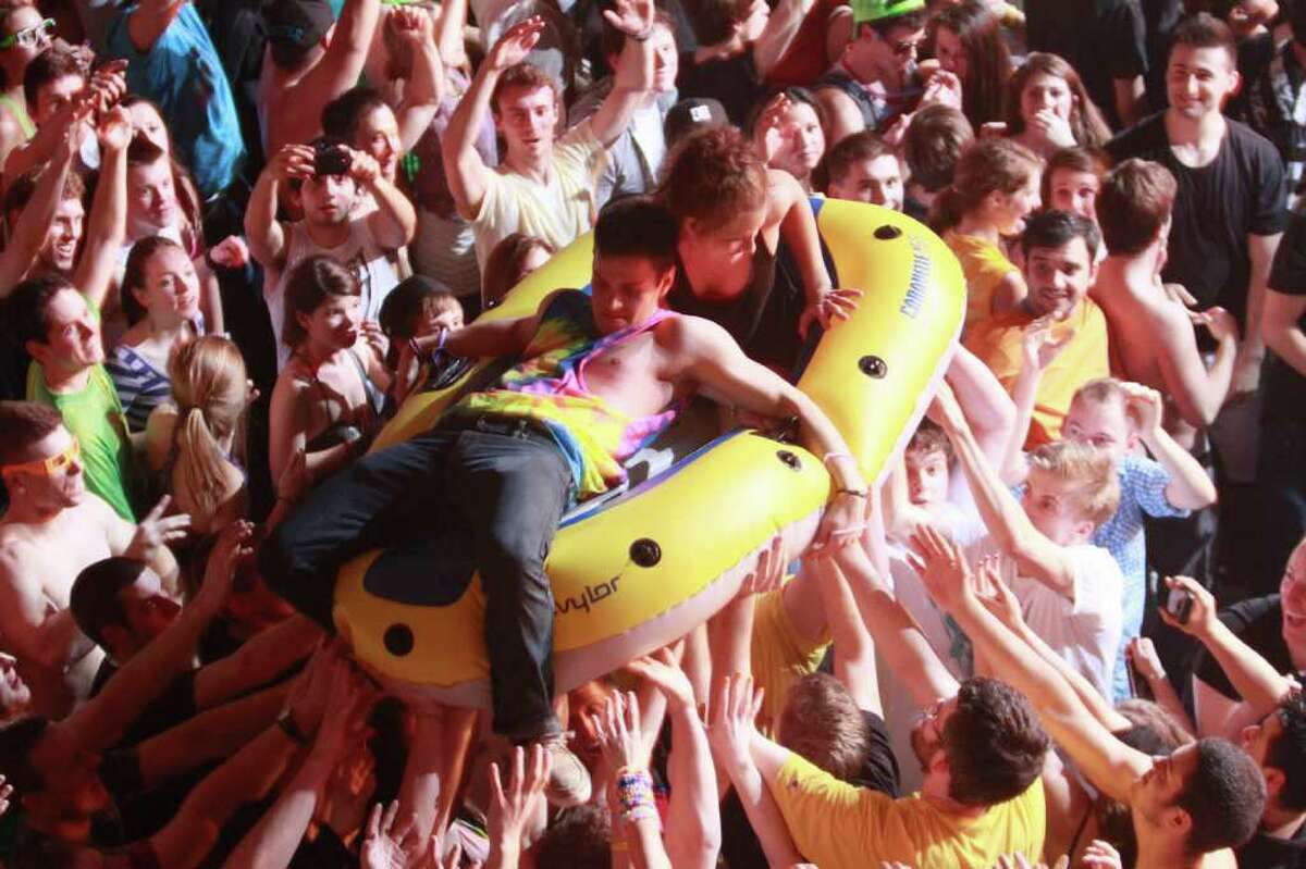 Fans surf the crowd in an inflatable raft during the Steve Aoki concert held at the Paramount theatre on Friday, Mar. 9, 2012. The Paramount theatre in Seattle was just one of the many venues Steve Aoki's Deadmeat tour will play at in North America.