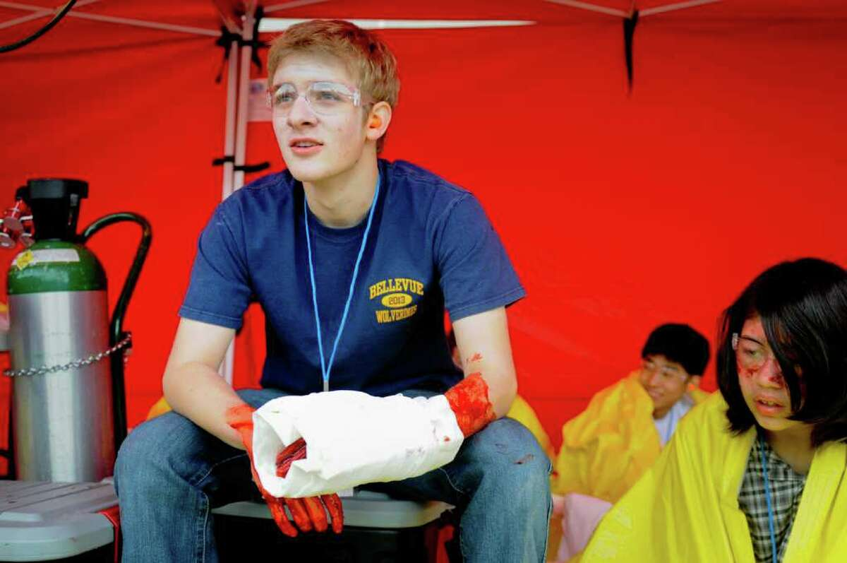 Matt Mckenna, 16, waits to be helped during a multiple shooter drill at Bellevue High School on Saturday, March 10, 2012. Planned since August, the drill tested the response and teamwork capabilities of many fire and police departments from across Western Washington. Dozens of Bellevue High School students were made up with fake wounds to make the drill more realistic, but had to wear glasses and earplugs for safety reasons. (Photo by Lindsey Wasson