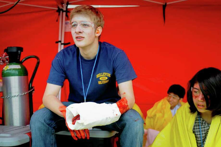 Matt Mckenna, 16, waits to be helped during a multiple shooter drill at Bellevue High School on Saturday, March 10, 2012. Planned since August, the drill tested the response and teamwork capabilities of many fire and police departments from across Western Washington. Dozens of Bellevue High School students were made up with fake wounds to make the drill more realistic, but had to wear glasses and earplugs for safety reasons. (Photo by Lindsey Wasson Photo: LINDSEY WASSON / SEATTLEPI.COM
