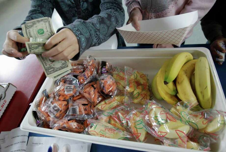 """FILE - The city's public schools will participate in a state """"healthy foods""""' program that will pay 10 cents per meal in exchange for a ban on soda, baked goods and candy sold during the school day. Photo: Paul Sakuma, Associated Press / AP"""