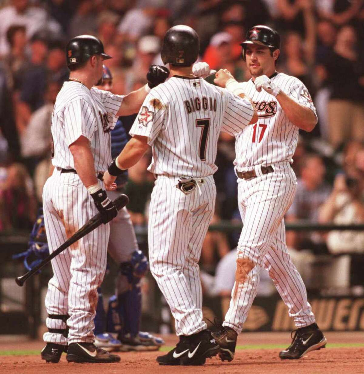 8/20/02--Houston Astros Jeff Bagwell and Craig Biggio welcome Lance Berkman home after his third inning two run home run against the Chicago Cubs Tuesday evening, Aug. 20, 2002, at Minute Maid Park in Houston. (Kevin Fujii/Chronicle) HOUCHRON CAPTION (08/21/2002): Jeff Bagwell, left, and Craig Biggio welcome Lance Berkman home after a two run homer in the third. HOUCHRON CAPTION (08/22/2002-2-STAR): Jeff Bagwell, left, and Craig Biggio welcome Lance Berkman home after a two-run homer in the third.