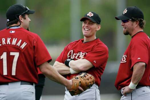 Lance Berkman, Craig Biggio and Jeff Bagwell share a laugh at the Houston Astros' Spring Training facilities, Friday, February 24, 2006, in Kissimmee, Florida, the first full squad workout for the Astros this spring.  (Karen Warren/Houston Chronicle) Photo: KAREN WARREN / Houston Chronicle