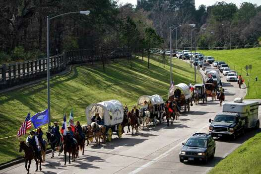 Trailriders ride along Memorial Parkway as they make their final push to Memorial Park  Friday, Feb. 26, 2010, in Houston.   Nothing brings to mind the Old West like a modern-day trail ride. Pioneers created trails as they moved west in search of a dream and cowboys created trails to take cattle to major market centers. While these routes are no longer a necessity in daily life, more than 4,000 riders saddle up each February to relive the Old West as part of 13 trail rides leading to the Houston Livestock Show and Rodeo.  ( Michael Paulsen / Chronicle ) Photo: Michael Paulsen / Houston Chronicle