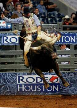 Logan Knibbe competes in Bull Riding during the Rodeo Houston BP Super Series II at Reliant Stadium on Friday, March 2, 2012, in Houston.  ( Mayra Beltran / Houston Chronicle Photo: Mayra Beltran / © 2012 Houston Chronicle