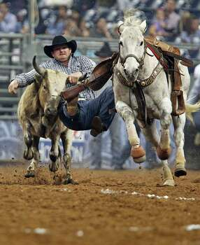 Wade Sumpter competes during the Steer Wrestling event Houston Livestock Show and Rodeo at Reliant Stadium Tuesday, March 6, 2012, in Houston. ( James Nielsen / Chronicle ) Photo: James Nielsen / © 2011 Houston Chronicle