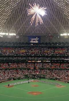 Richard Carson. FINAL OPENING NIGHT 1999--The Houston Astros and the Chicago Cubs line the base path as fireworks explode overhead on opening night of the last season of professional baseball in the Houston Astrodome April 6, 1999. HOUCHRON CAPTION (10/03/1999): None  HOUSTON CHRONICLE SPECIAL SECTION: THE WONDER YEARS/35 SEASONS OF BASEBALL IN THE ASTRODOME. Photo: Richard Carson / Houston Chronicle