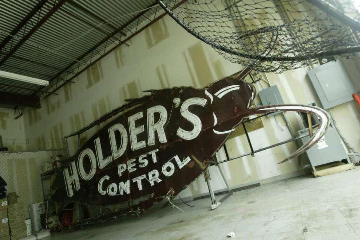 Bubba, the giant roach sign, is stored at Holder's Pest Control Warehouse in Houston, June 25, 2004. (Meg Loucks/ Houston Chronicle)
