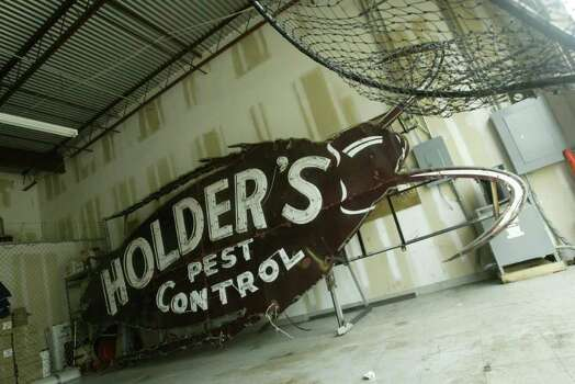 Bubba, the giant roach sign, is stored at Holder's Pest Control Warehouse in Houston, June 25, 2004. (Meg Loucks/ Houston Chronicle) Photo: Meg Loucks / Houston Chronicle