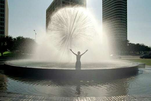 CONTACT FILED:  WORTHAM FOUNTAIN-HOUSTON Alejandro Martinez, 10, soaks up the spray and sun in Wortham Fountain, Allen Parkway, under a clear sky of a spring-like day in Houston, Sunday, 01/27/02. (Buster Dean / Chronicle).     HOUCHRON CAPTION (01/28/2002):  Alejandro Martinez, 10, soaks up the sunshine Sunday along with water spray from  Wortham Fountain on Allen Parkway between Waugh and Montrose. Photo: Buster Dean / Houston Chronicle