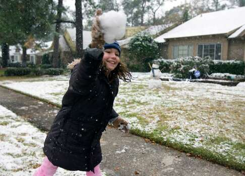 Ten-year-old Chloe Gentry throws a snowball at her friend Sara Wells (NOT SHOWN) Friday, Dec. 4, 2009, in Houston. ( James Nielsen / Chronicle ) Photo: James Nielsen / Houston Chronicle