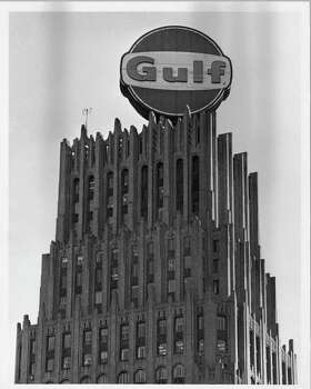 "PHOTO FILED: GULF BUILDING-HOUSTON.  11/22/1973 - Giant Sign victim of energy crisis.  Workmen dismantling  sign atop Gulf Building, Nov. 22,1973.  Blair Pittman / Houston Chronicle  HOUCHRON CAPTION (11/22/1973): GIANT SIGN VICTIM OF ENERGY CRISIS. Workmen Dismantling Sign Atop Gulf Bldg.  HOUCHRON CAPTION (12/12/1999): 1929: Jesse Jones completed construction of the 35-story Gulf Building, now the Chase Bank Building, which remained the city's tallest until 1963. The Gulf ""lollipop"" topped the building from the mid-'60s until 1973. HOUSTON CHRONICLE SPECIAL SECTION: THE HOUSTON CENTURY. Photo: Blair Pittman / Houston Chronicle"