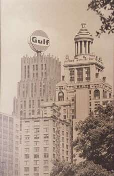 "CONTACT FILED:  GULF BUILDING-HOUSTON COPY SHOT - A black and white photo (undated) shows part of the downtown skyline that, at one time, included the world's largest rotating sign atop the Gulf building.   HOUCHRON CAPTION (04/15/2001):  Known as ""The Lollipop,"" Gulf Oil Co.'s rotating orange, white and blue logo towered above most other downtown buildings in the 1960s and early '70s. It was removed in 1975. / HANDOUT"
