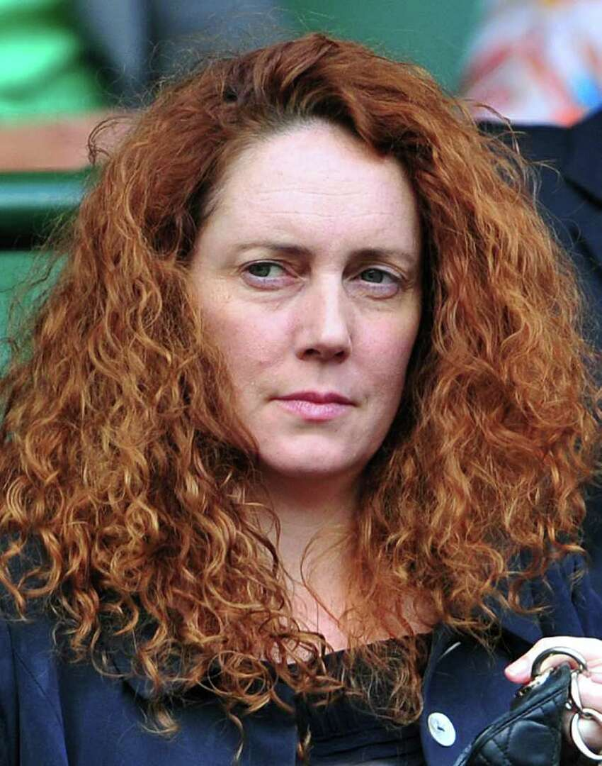 Chief Executive of News International Rebekah Brooks attends the semi final match between Serbian player Novak Djokovic and French player Jo-Wilfried Tsonga during the men's single semi final at the Wimbledon Tennis Championships at the All England Tennis Club, in southwest London on July 1, 2011. AFP PHOTO / LEON NEAL/RESTRICTED TO EDITORIAL USE