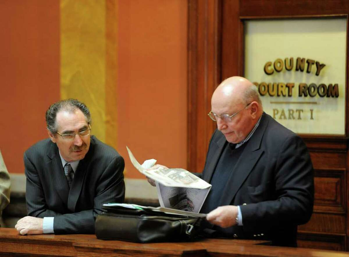 Michael LoPorto joined by his attorney Michael Feit, wait outside Judge George Pulver?s courtroom in Troy, N.Y. March 13, 2012. Judge Pulver declared a mistrial in ballot fraud case which LoPorto and Edward McDonough are defendants. (Skip Dickstein / Times Union)