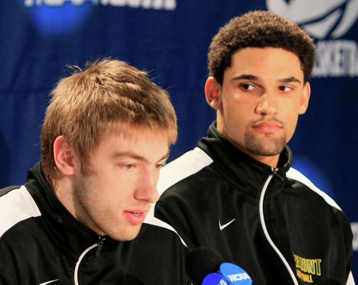 Vermont players Matt Glass, left, and Luke Apfeld answer questions at a news conference, Tuesday, March 13, 2012, in Dayton, Ohio. Vermont plays Lamar, Wednesday evening in a first round NCAA tournament basketball game. (AP Photo/Al Behrman)
