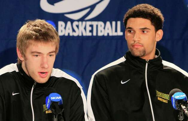 Vermont players Matt Glass, left, and Luke Apfeld answer questions at a news conference, Tuesday, March 13, 2012, in Dayton, Ohio. Vermont plays Lamar, Wednesday evening in a first round NCAA tournament basketball game. (AP Photo/Al Behrman) Photo: Al Behrman, STF / AP