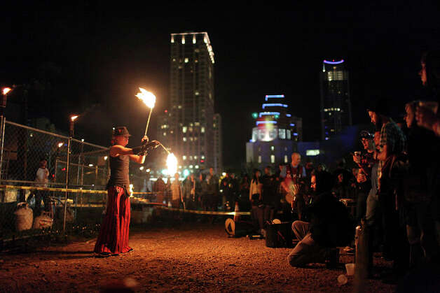 Fire dancer Aaron Thurston performs at Livefyre's Fyre Bash at the Fyre Pit during South by Southwest on March 11, 2012,  in Austin. Photo: EDWARD A. ORNELAS, Edward A. Ornelas/Express-News / © SAN ANTONIO EXPRESS-NEWS (NFS)
