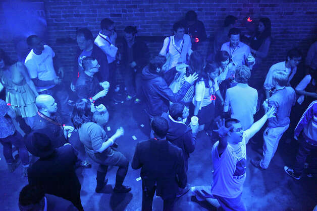 People dance at the Rackspace party at the Bat Bar during South by Southwest on March 11, 2012,  in Austin. Photo: EDWARD A. ORNELAS, Edward A. Ornelas/Express-News / © SAN ANTONIO EXPRESS-NEWS (NFS)