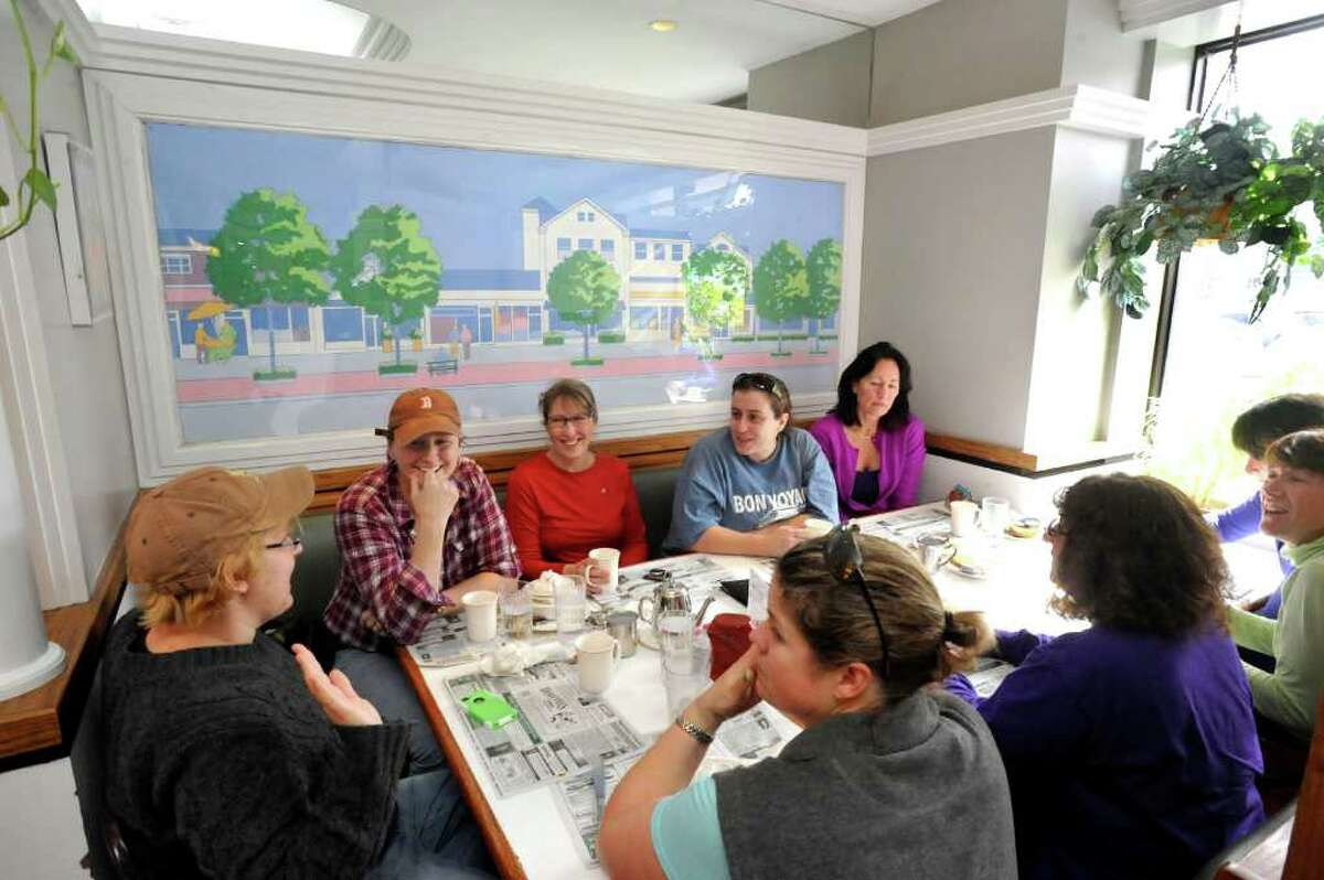 Customers enjoy a window booth at Dimitri's Diner in Ridgefield Friday, March 9, 2012.