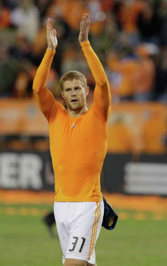 Andre Hainault deserves the applause after scoring the lone goal in the Dynamo's opener. Photo: Melissa Phillip / © 2011 Houston Chronicle