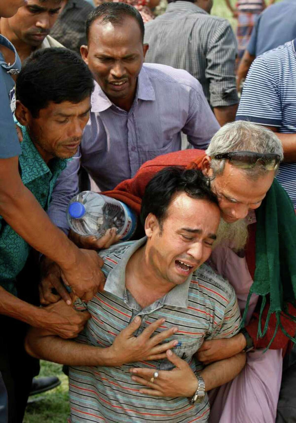 Victims' relatives thronged the banks of the Meghna River south of Dhaka, Bangladesh, on Tuesday.