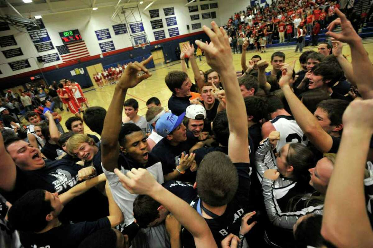 Immaculate fans swarm the court after Immaculate beat Northwestern Regional 76-51 in their Class S state semifinal game at Plainville High School on Tuesday, March 13, 2012.