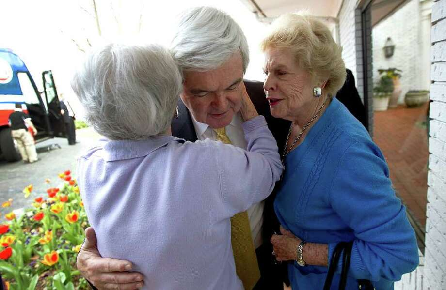 Republican presidential candidate Newt Gingrich (C) is hugged by Helen Smalley (R) and Betty Weeks (L) after speaking to the Vestavia Hills Chamber of Commerce at the Vestavia Hills Country Club March 13, 2012 in Birmingham, Alabama. As the race for delegates continues, voters in Alabama and Mississippi will cast their ballots in their primaries today. Photo: Win McNamee, Getty Images / 2012 Getty Images