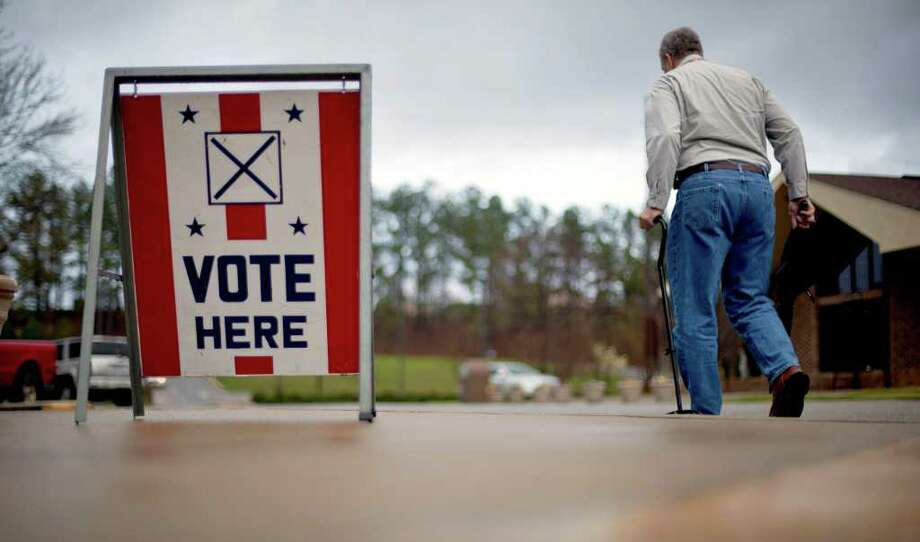 A voter leaves a polling place in Birmingham, Ala., Tuesday, March 13, 2012. Alabama voters would be deciding Tuesday whether Mitt Romney has deep South appeal, if it's time for Newt Gingrich to go forward or go home, and whether Rick Santorum can trim the Republican field. Photo: David Goldman, Associated Press / Copyright 2012 The Associated Press. All rights reserved. This material may not be published, broadcast, rewritten or redistribu