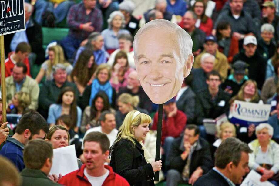 Christina Villagomez attracts the attention of caucus voters as she walks through the Lakeland High School gymnasium in Rathdrum, Idaho with an overside Ron Paul head Tuesday, March 6, 2012. Photo: Jerome A Pollos, Associated Press / Coeur d'Alene Press