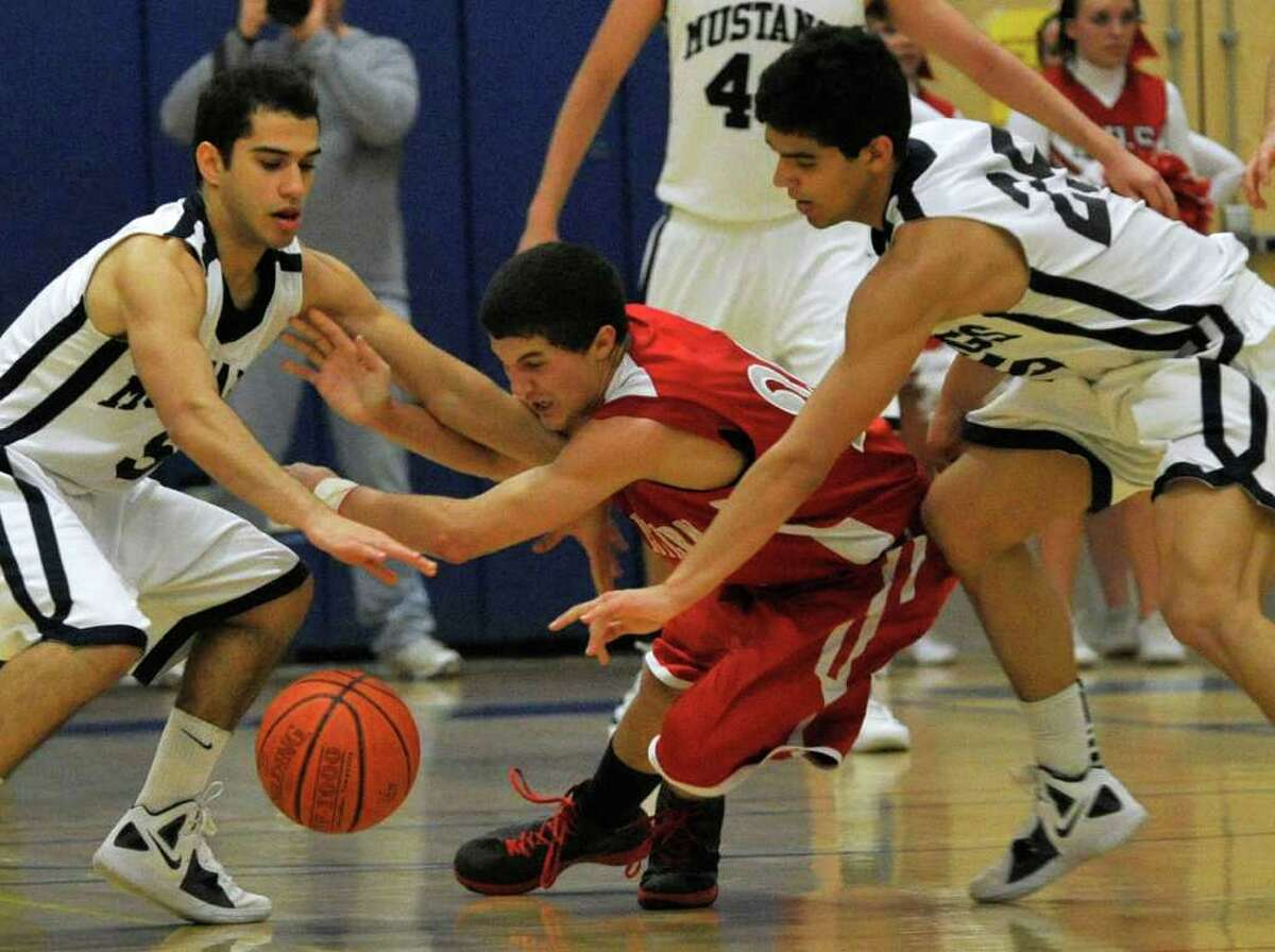 Immaculate's Marcos DeOliveira, left, and Felipe Teixeira force the ball loose from Northwestern Regional's Connor Guiheen during their Class S state semifinal game at Plainville High School on Tuesday, March 13, 2012. Immaculate won 76-51.