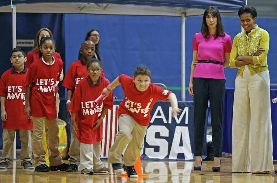 U.S. First Lady Michelle Obama (R) and Samantha Cameron (2nd R), wife of British Prime Minister Davi